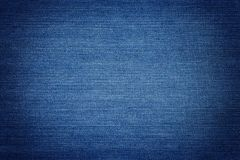 Blue Denim. Background, detailed texture with vignette Royalty Free Stock Images