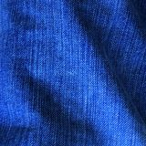Blue denim. Texture with some folds in it royalty free stock photography