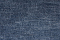 Blue denim background, jeans fabric,. Close-up of jeans textile Royalty Free Stock Image