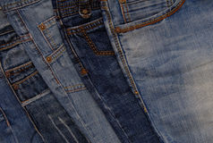 Blue denim background, pile of  jeans. Blue denim background, pile of different jeans Stock Photos