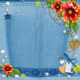 Blue Denim Background With Flowers And Pearls. Royalty Free Stock Photos