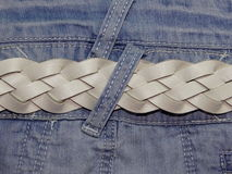 Blue denim with belt Stock Images