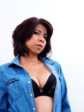 Blue denim blouse over black bra Royalty Free Stock Photo