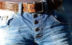 Blue Denim Button Up Bottoms With Belt Stock Photo