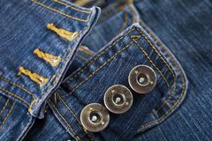 Blue denim buttons for background. Blue denim button for background, detailed texture stock image