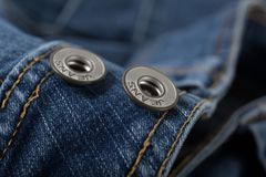 Blue denim buttons for background. Blue denim button for background, detailed texture royalty free stock photography