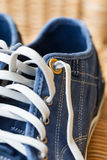 Blue denim casual canvas shoe with laces Stock Photos