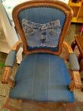 Teak chair with denim cloth royalty free stock photos