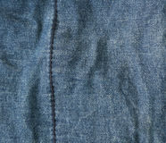 Blue denim close-up and a vertical seam Stock Photography