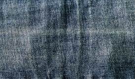 Blue denim close-up and a vertical seam Royalty Free Stock Images