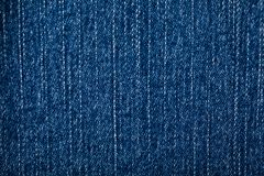 Blue denim cloth for background. Blue denim background, detailed texture with vignette royalty free stock images