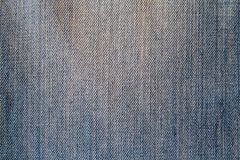 Blue denim fabric close-up Stock Images