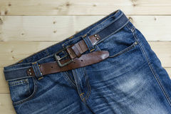 Blue denim jean on the wood background Stock Photography