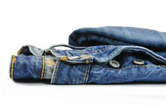 Blue Denim Jeans. Close up of a washed-out blue denim jeans isolated on white Stock Image