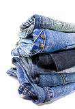 Blue denim jeans. Stack of blue denim jeans on white background Royalty Free Stock Photo