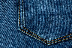 Blue denim jeans background pocket with seam and orange thread stitches. Casual urban classic fashion tailoring clothing concept. Poster banner template with royalty free stock photos