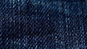 Blue denim jeans close up 4K stock footage. Blue denim Jeans in close up. With a sliding camera move stock footage
