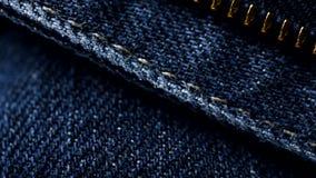 Blue denim jeans close up 4K stock footage. Blue denim Jeans in close up. With a sliding camera move stock video footage