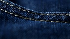 Blue denim jeans close up 4K stock footage. Blue denim Jeans in close up. With a sliding camera move stock footage