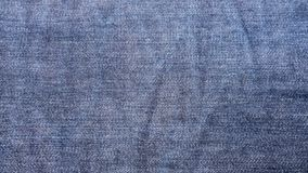 Blue denim jeans cloth as background. Close up inside of raw denim dark wash indigo blue jeans texture background. fashion concept Stock Photo