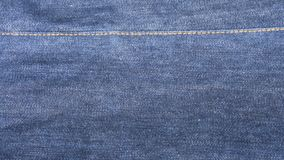 Blue denim jeans cloth as background. Close up inside of raw denim dark wash indigo blue jeans texture background. fashion concept Royalty Free Stock Images