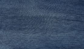 Blue denim jeans fabric background stock images
