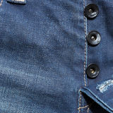 Blue denim jeans pants. With black button Royalty Free Stock Photos