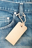 Blue denim jeans with paper label Stock Photography