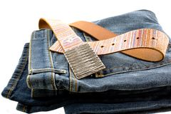 Blue denim jeans and strap leather belt Stock Images