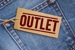 Blue denim jeans with tags. Outlet Sale royalty free stock image