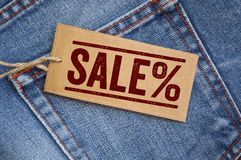 Blue denim jeans with tags. Outlet Sale royalty free stock images