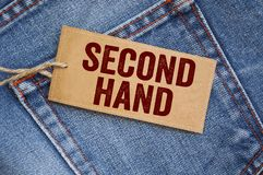 Blue denim jeans with tags. Sale Second hand royalty free stock image