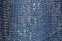Blue denim jeans textile with distressed texture pattern, a few Royalty Free Stock Photography