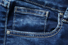 Blue denim jeans texture and background with seams. Blue denim jeans texture and background Jeans pocket Royalty Free Stock Photography