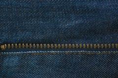 Blue denim jeans texture with zipper, background Stock Photos