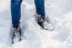 Blue Denim Jeans And Winter Boots In Snow Stock Photo