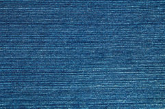 Blue denim material. Close-up of blue denim material Stock Images