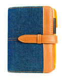 Blue denim notebook with pen. Blue denim notebook with orange pen, on white background stock photography