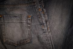 Denim pants are on old linen burlap abstract background royalty free stock photography