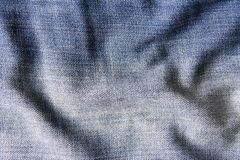 Blue denim rumpled fabric can be used as background stock photos