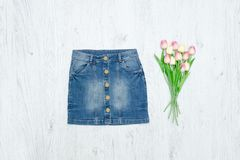 Blue denim skirt and bouquet of tulips. Fashion Concept.  stock photos