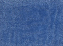Blue denim textile texture. Stock Photos