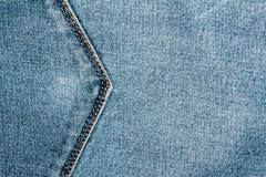 Blue denim texture with a stitch in the form of an arrow indicating the direction. Abstrack background Royalty Free Stock Photo