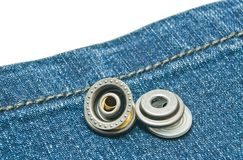 Blue denim with two metal buttons Stock Images