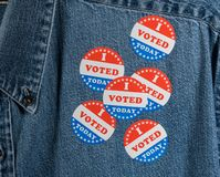 Blue denim working clothing with many Voted stickers royalty free stock image