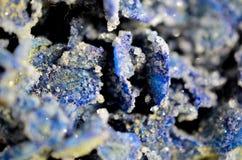 Blue desert rose 4. Piece of Sahara - mineral blue desert rose abstract background, extreme macro shot Royalty Free Stock Image