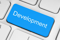 Blue development button Stock Image