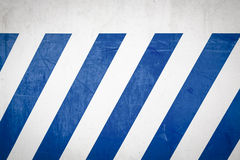 Blue diagonal stripes on a wall Stock Images