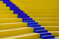 Blue diagonal. Yellow concrete stadium and the amphitheater stairs painted blue Royalty Free Stock Photo