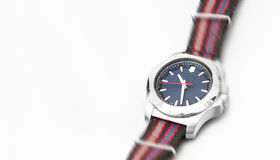 A blue dial watch on a colourful strap looks as if it is moving Royalty Free Stock Photo